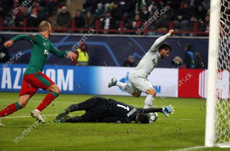 Stock Image of Kevin Volland (R) of Leverkusen in action against goalkeeper Guilherme (C) and Benedikt Howedes (L)  of Lokomotiv during the UEFA Champions League Group D soccer match between Lokomotiv Moscow and Bayer Leverkusen in Moscow, Russia, 26 November 2019.