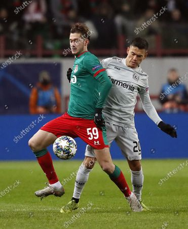 Aleksei Miranchuk (L) of Lokomotiv in action against Charles Aranguiz (R) of Leverkusen during the UEFA Champions League Group D soccer match between Lokomotiv Moscow and Bayer Leverkusen in Moscow, Russia, 26 November 2019.