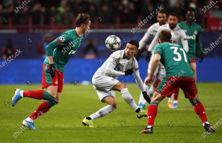 Aleksei Miranchuk (L) and Maciej Rybus (R) of Lokomotiv in action against Charles Aranguiz (C) of Leverkusen during the UEFA Champions League Group D soccer match between Lokomotiv Moscow and Bayer Leverkusen in Moscow, Russia, 26 November 2019.