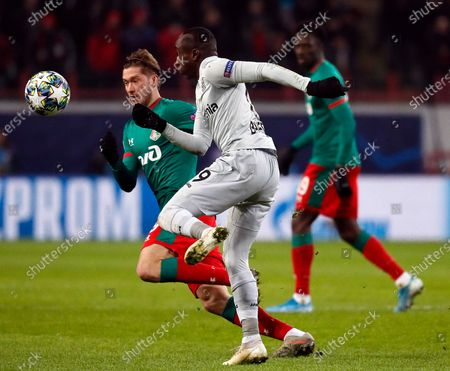 Aleksei Miranchuk (L) of Lokomotiv in action against Moussa Diaby (R) of Leverkusen during the UEFA Champions League Group D soccer match between Lokomotiv Moscow and Bayer Leverkusen in Moscow, Russia, 26 November 2019.