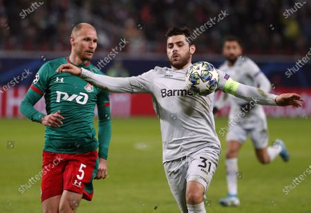Stock Photo of Benedikt Howedes (L) of Lokomotiv in action against Kevin Volland (R) of Leverkusen during the UEFA Champions League Group D soccer match between Lokomotiv Moscow and Bayer Leverkusen in Moscow, 26 November 2019.