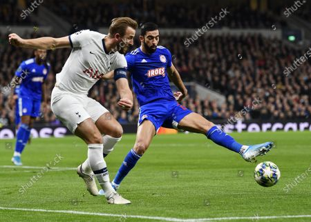 Harry Kane (L) of Tottenham in action against Yassine Meriah of Olympiacos during the UEFA Champions League Group B match between Tottenham Hotspur and Olympiacos Piraeus in London, Britain, 26 November 2019.