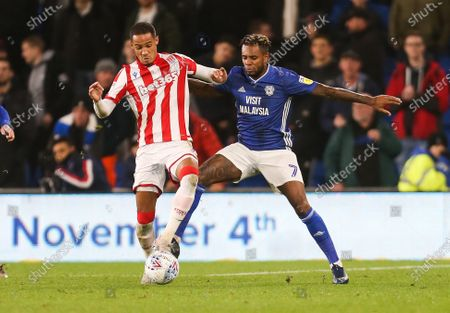 Leandro Bacuna of Cardiff City and Tom Ince of Stoke City compete for the ball