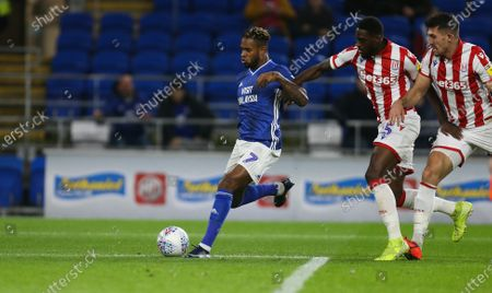 Leandro Bacuna of Cardiff City shoots to score goal