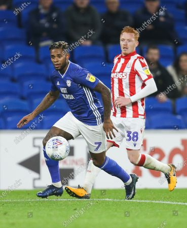Leandro Bacuna of Cardiff City takes on Ryan Woods of Stoke City
