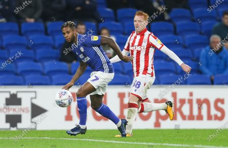 Stock Image of Leandro Bacuna of Cardiff City takes on Ryan Woods of Stoke City