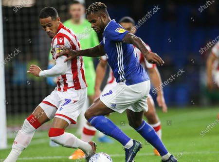 Stock Picture of Leandro Bacuna of Cardiff City takes on Tom Ince of Stoke City