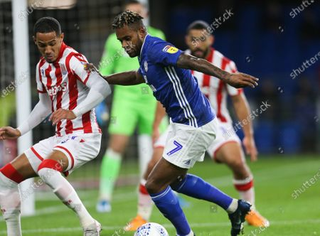 Leandro Bacuna of Cardiff City takes on Tom Ince of Stoke City