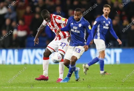 Junior Hoilett of Cardiff City takes on Badou NDiaye of Stoke City