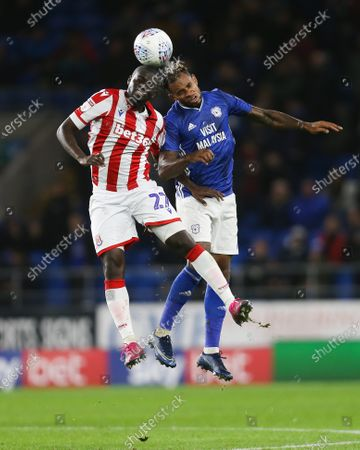 Badou NDiaye of Stoke City and Leandro Bacuna of Cardiff City compete for the ball