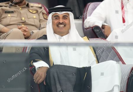 Qatar's Emir Sheikh Tamim bin Hamad al-Thani attends the 24th Arabian Gulf Cup Group A football match between Qatar and Iraq at the Khalifa International stadium in Doha, Qatar on November 26, 2019.