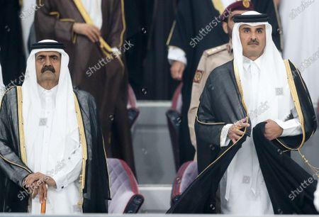 Qatar's Emir Sheikh Tamim bin Hamad al-Thani (R) and The Father Amir Sheikh Hamad bin Khalifa Al Thani (L) is the former Amir of the State of Qatar attend the 24th Arabian Gulf Cup Group A football match between Qatar and Iraq at the Khalifa International stadium in Doha, Qatar on November 26, 2019.