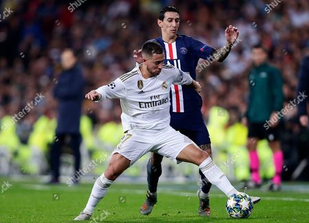 Real Madrid's Eden Hazard, foreground, fights for the ball with PSG's Angel Di Maria during a Champions League soccer match Group A between Real Madrid and Paris Saint Germain at the Santiago Bernabeu stadium in Madrid, Spain