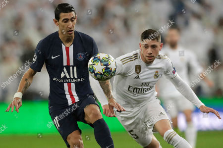 PSG's Angel Di Maria fights for the ball against Real Madrid's Federico Valverde during a Champions League soccer match Group A between Real Madrid and Paris Saint Germain at the Santiago Bernabeu stadium in Madrid, Spain