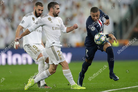 PSG's Kylian Mbappe fights for the ball against Real Madrid's Dani Carvajal during a Champions League soccer match Group A between Real Madrid and Paris Saint Germain at the Santiago Bernabeu stadium in Madrid, Spain