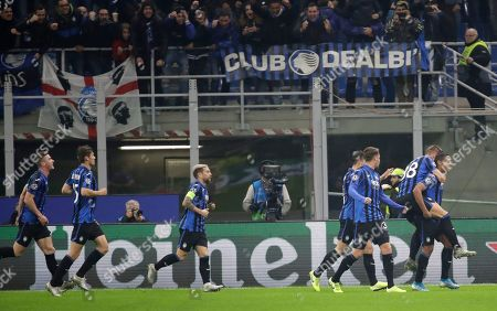 Atalanta's Luis Muriel, right, celebrates with his teammates after scoring his sides first goal during the Champions League group C soccer match between Atalanta and Dinamo Zagreb at the San Siro stadium in Milan, Italy