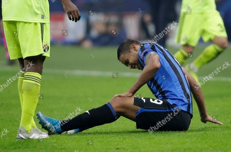 Atalanta's Luis Muriel grimaces after suffering an injury during the Champions League group C soccer match between Atalanta and Dinamo Zagreb at the San Siro stadium in Milan, Italy
