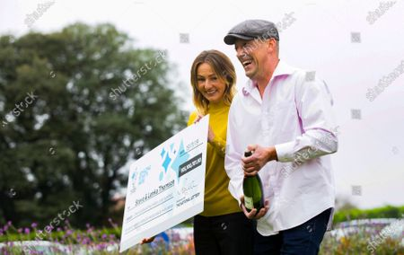 Steve Thomson, and his wife Lenka,celebraing their £105m EuroMillions win today at the Hilton Avisford Park, Walberton