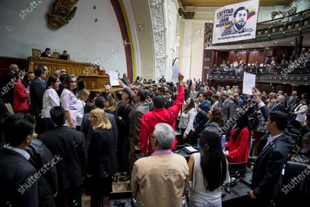 Deputies of the National Assembly of Venezuela, of the United Socialist Party of Venezuela (PSUV), shout slogans against Javier Maroto, spokesman for the PP in the Spanish Senate, Jose Ignacio Echaniz, deputy spokesman for the PP in Spanish Congress; Valentina Martinez, secretary of International Relations of the PP and Belen Hoyo, President of the National Electoral Committee of the PP, in the hemiciclo of sessions of the organism, after the event 'World parliamentary meeting for democracy', in Caracas, Venezuela, 26 November 2019. The intervention by surprise in the Venezuelan National Assembly (AN) of Spanish senator Javier Maroto and deputy Jose Ignacio Echaniz, both of the Popular Party (PP, right), unleashed a altercation between opposition and official deputies that ended in insults Among congressmen.