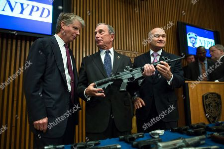 File-This photo from, shows District Attorney Cyrus Vance, left, Mayor Michael Bloomberg, center, NYPD Police Commissioner Ray Kelly, right, with confiscated illegal firearm during a press conference in New York. Bloomberg announced in May 2006 that he was suing 15 dealers he accused of selling firearms illegally in other states, resulting in court-appointed monitoring for many targeted shops