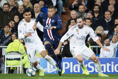 Kylian Mbappe of PSG in action against Casemiro and Daniel Carvajal of Real Madrid
