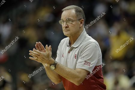 Oklahoma head coach Lon Kruger cheers on his team during the second half of an NCAA college basketball game against Missouri, in Kansas City, Mo. Oklahoma won 77-66