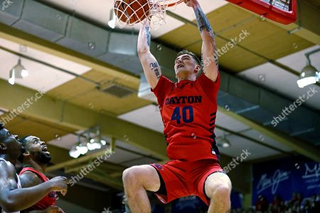 Dayton forward Chase Johnson (40) makes a dunk over Virginia Tech during the first half of an NCAA college basketball game, in Lahaina, Hawaii
