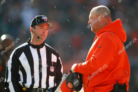 Freddie Kitchens, Aaron Santi. Cleveland Browns head coach Freddie Kitchens talks with field judge Aaron Santi (50) during an NFL football game, in Cleveland. The Browns won the game 41-24