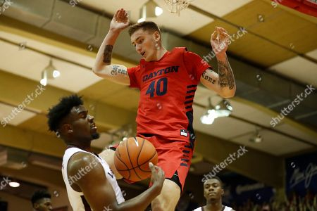Chase Johnson, Isaiah Wilkins. After making a dunk, Dayton forward Chase Johnson (40) crashes into Virginia Tech guard Isaiah Wilkins (1) during the first half of an NCAA college basketball game, in Lahaina, Hawaii