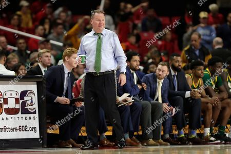 George Mason head coach Dave Paulsen looks on during the first half of an NCAA college basketball game against Maryland, in College Park, Md