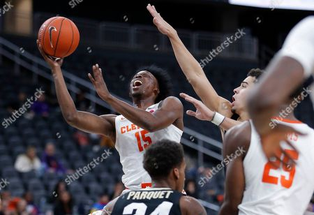 Clemson's John Newman III (15) shoots against Colorado during the first half on an NCAA college basketball game, in Las Vegas