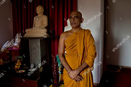 Outspoken Buddhist monk and member of Parliament, Athuraliye Rathana stands for a photograph inside a housing complex near an upcoming temple in Colombo, Sri Lanka. With the day-to-day violence of the civil war in the past, Buddhist nationalists in recent years have accused the government of paying too much heed to the needs of minorities, pointing in part to the previous government, which though led by Sinhalese Buddhists, also included ministers who were Hindu and Muslim. Weeks after the Easter bombings, Rathana began a fast in front of the Sacred Tooth temple demanding the resignation of a Muslim Cabinet minister in then-President Maithripala Sirisena's government and two Muslim governors he accused of having links to the attacks