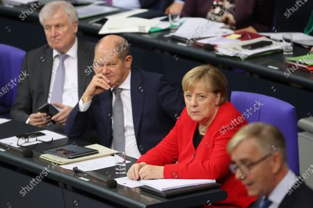 (L-R) german Minister of Interior, Construction and Homeland Horst Seehofer, Minister of Finance Olaf Scholz and German Chancellor Angela Merkel listen while German The Left (Die Linke) party faction co-chairman in the German parliament Bundestag Dietmar Bartsch (R) speaks during a session of the German parliament 'Bundestag' in Berlin, Germany, 27 November 2019. Members of Bundestag debate on the government policy.