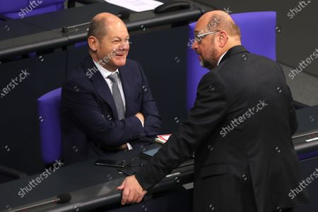 German Minister of Finance Olaf Scholz (L) and Martin Schulz (R) of the Social Democratic Party (SPD) talk during a session of the German parliament 'Bundestag' in Berlin, Germany, 27 November 2019. Members of Bundestag debate on the government policy.