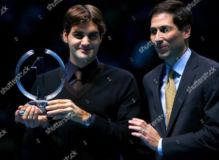 Roger Federer of Switzerland receives the 2009 year end No.1 trophy from Adam Helfant, ATP Executive Chairman and President.