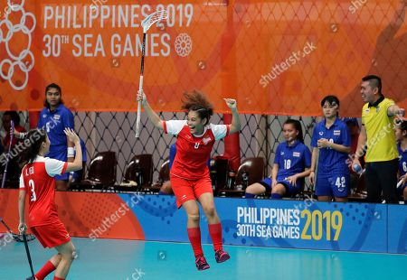 SingaporeÅfs floorball player Siti Nurhaliza Khairul Anuar celebrates after scoring a goal during their womenÅfs preliminary round match against Thailand at the 30th South East Asian Games in Manila, Philippines on . The country is hosting the SEA games that officially opens on Nov. 30-Dec. 11. Singapore won 4-1
