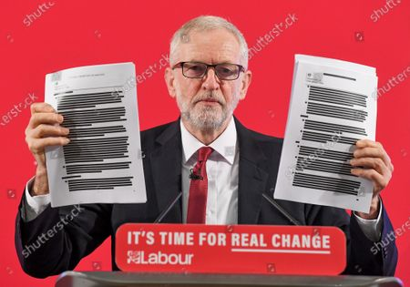 Jeremy Corbyn holds up a redacted Department for International Trade report, of UK-US Trade and Investment Working Group from July 2018.