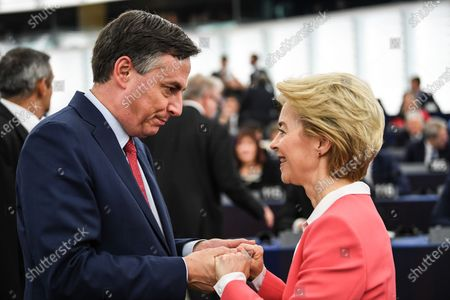 Stock Image of Member of Parliament from the European People's Party group David McAllister (L)  speaks with European Commission President-elect Ursula von der Leyen (R) before her adress to the European Parliament ahead of a vote of Members of the European Parliament on her college of commissioners, in Strasbourg, France, 27 November 2019.