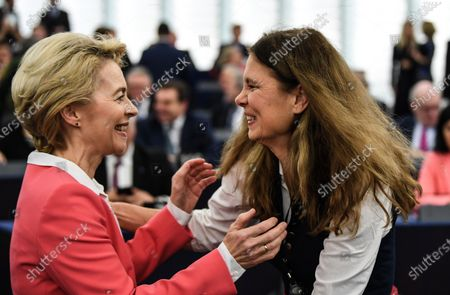 Stock Picture of European Commission President-elect Ursula von der Leyen (L) speaks with Green MEP and TV chef Sarah Wiener (R) before the adress to the European Parliament ahead of a vote of Members of the European Parliament on her college of commissioners, in Strasbourg, France, 27 November 2019.