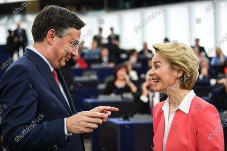 Member of Parliament from the European People's Party group David McAllister (L)  speaks with European Commission President-elect Ursula von der Leyen (R) before her adress to the European Parliament ahead of a vote of Members of the European Parliament on her college of commissioners, in Strasbourg, France, 27 November 2019.
