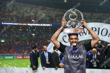Stock Photo of Al-Hilal's Abdullah Al-Mayouf holds the trophy