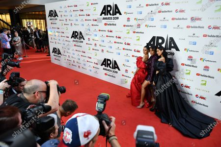 Stock Photo of Lisa Origliasso, Jessica Mauboy and Jessica Origliasso arrive for the 33rd Annual ARIA Music Awards at The Star in Sydney, Australia, 27 November 2019.