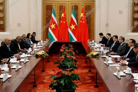 President of Suriname Desi Bouterse (L) and Chinese Premier Li Keqiang (R) speak during a meeting at the Great Hall of the People in Beijing, China, 27 November 219.