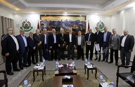 Palestinian Hamas chief in the Gaza strip, Ismail Haniyeh, meets with Chairman of the Palestinian Central Election Committee Hanna Nasser