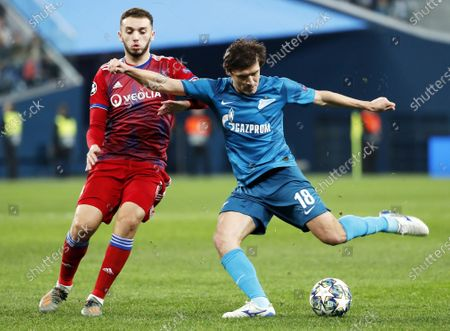 Yuri Zhirkov (R) of Zenit in action against Amine Gouiri (L) of Lyon during the UEFA Champions League group G soccer match between Zenit St Petersburg and Olympique Lyon in Saint Petersburg, Russia, 27 November 2019.