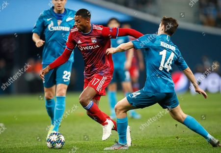 Lyon's Jeff Reine-Adelaide, centre, and Zenit's Daler Kuzyayev challenge for the ball during the Champions League group G soccer match between Zenit St. Petersburg and Lyon at the Saint Petersburg stadium in St. Petersburg, Russia