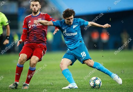 Zenit's Yuri Zhirkov, right, kicks the ball ahead of Lyon's Amine Gouiri during the Champions League group G soccer match between Zenit St. Petersburg and Lyon at the Saint Petersburg stadium in St. Petersburg, Russia