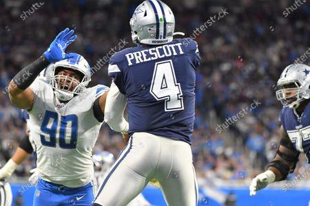 DETROIT, MI - : Detroit Lions DE Trey Flowers (90) tries to get to Dallas Cowboys QB Dak Prescott (4) during NFL game between Dallas Cowboys and Detroit Lions on at Ford Field in Detroit, MI