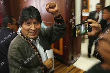 Bolivia's former President Evo Morales pumps his fist after a press conference at the journalists club in Mexico City, . Morales went into exile in Mexico after he was prodded by police and the military, forcing him to resigned on Nov. 10, after he claimed victory in an election that international observers invited in by the government said was marred by numerous irregularities