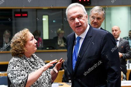 Stock Picture of Italian Vice Minister for Foreign Affairs Emanuela Claudia Del Rethe (L) and EU Commissioner for International Cooperation and Development Neven Mimica (R)